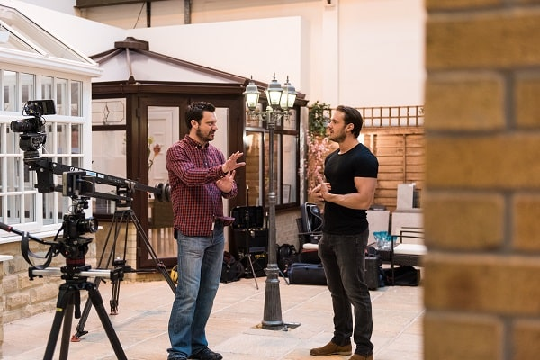 stada blog post - 3 stages video production - two men talking on film set